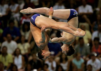 Australia's Robert Newbery and Mathew Helm dive in mens 10 metre synchronized diving at the Olympic ...