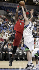 Raptors O'Neal cannot score around Timberwolves Love during NBA game in Minneapolis