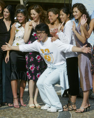 JACKIE CHAN POSES WITH MISS WORLD CONTESTANTS IN SANYA, CHINA.