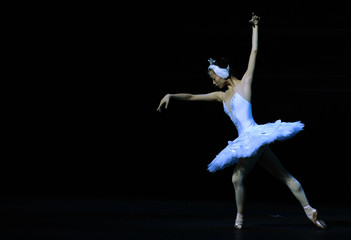Ballerina performs during a dress rehearsal for a new production of Swan Lake in London