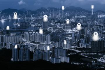 Map pin flat on blue tone Hong Kong cityscape background.
