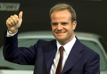 Brazilian Rubens Barrichello  gives a thumbs up as he poses during the official presentation of the ..