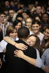 U.S. Senator Barack Obama hugs a supporter at a rally at Chicago