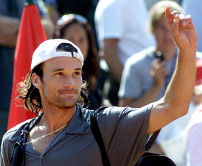 SPANISH MOYA CELEBRATES VICTORY AT SEMIFINAL MATCH AT BARCELONA TENNIS OPEN.