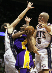 Los Angeles Lakers Bryant plays against New Jersey Nets Krstic and Kidd in East Rutherford