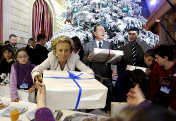 French President Chirac and his wife Bernadette hand presents to children of Elysee Palace employees and children coming from various French schools during traditional Christmas party at Elysee Palace in Paris