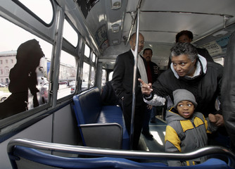 Child looks at picture of Rosa Parks on antique 1957 bus in Washington