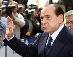 Italy's Prime Minister Berlusconi arrives at the European Council headquarters on the first day of EU summit in Brussels