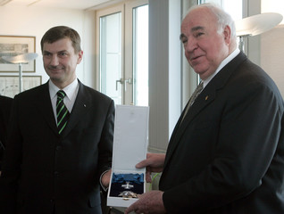 Estonian Prime Minister Ansip presents former German chancellor Kohl with a Marienland medal in Berlin