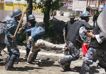 Armed Nepali police beats pro democracy demonstrator at Gonagabu in capital Kathmandu