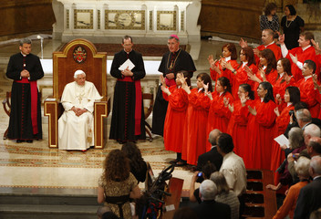 Pope Benedict XVI watches a choir use sign language to perform a song during a ceremony to bless handicapped youth and their caregivers in the chapel at St. Joseph's Seminary in Yonkers, New York