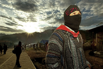 ZAPATISTA REBEL STANDS GUARD IN VILLAGE OF OVENTIC IN MEXICO.