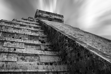 An upwards perspective of the stepped pyramid of the main Temple at the Mayan Ruins in Chichen Itza.