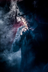 Man with beard smoking electronic sigarette