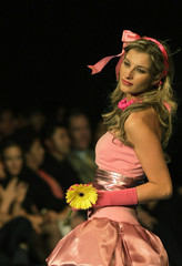 A model displays a creation from the Monopol collection during Bolivia Fashion Week in La Paz