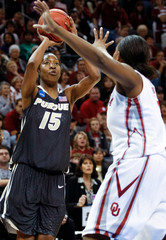 Purdue forward Danielle Campbell shoots against Oklahoma foward Ashley Paris in the second half of the NCAA Division I Women's Regional basketball final in Oklahoma City