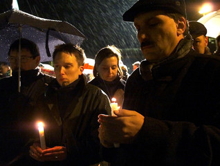 PEOPLE HOLD CANDLES DURING A CEREMONY FOR HOLOCAUST MEMORIAL DAY IN BERLIN.