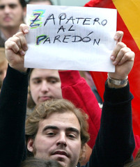 POPULAR PARTY SUPPORTER HOLDS UP A BANNER DURING DEMO IN MADRID.