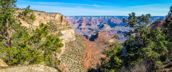 People enjoying panoramic views from a viewing area along Bright Angel Trail. Grand Canyon National Park.