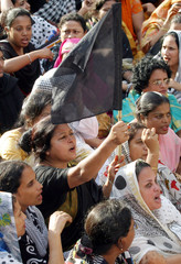 Opposition supporter holding black flag chants slogans during protest rally in Dhaka