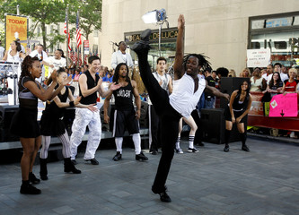 Members of Broadway show Hot Feet perform with band Earth Wind and Fire on Today Show in New York