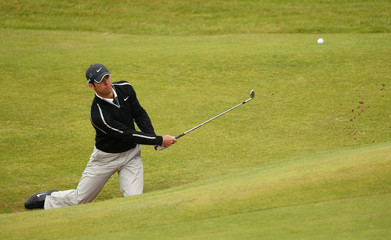 Paul Casey of England hits out of a bunker during the second round of the British Open Golf Championship at the Turnberry Golf Club in Scotland