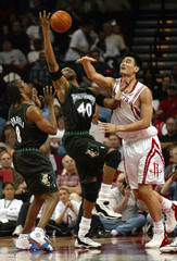 TIMBERWOLVES JOHNSON AND SPREWELL GO AGAINST ROCKETS YAO MING FOR REBOUND.