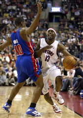 Pistons guard Hunter fouls Raptors guard James during first half of their NBA game in Toronto