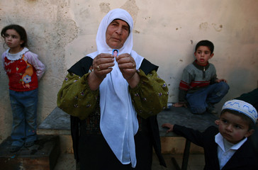 Grandmother of Marei Radaydeh shows picture in East Jerusalem