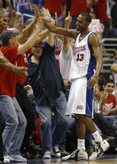 Clippers Ross celebrates with fans after sinking basket against Suns during Game 6 of NBA Western Conference semifinals playoffs series in Los Angeles