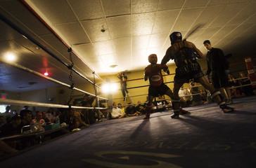 Nigel Soreta and Wayne Palombo square off during an amateur Muay Thai fight in Stoney Brook