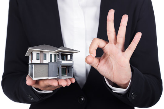 house in business human hand and OK sign isolated on white