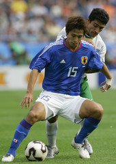 Japan's Fukunishi challenges Mexico's Zinha during their Confederations Cup soccer match in Hanover.