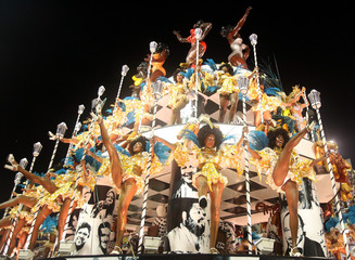 Revelers of the Unidos da Tijuca samba school perform during second night of Carnival parades at Sambadrome in Rio de Janeiro