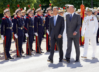 Portugal's President Cavaco Silva and Spain's King Juan Carlos review royal guard troops in Madrid