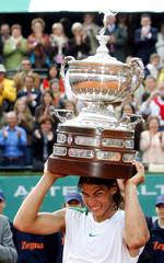 Spanish tennis player Nadal holds up the trophy after winning the Barcelona Open tournament in Spain
