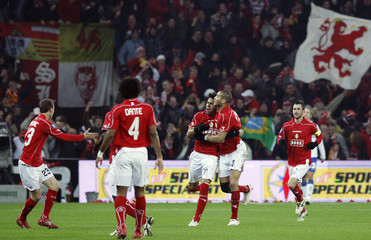 Standard Liege's players celebrate after De Camargo scored a goal during their UEFA Cup soccer match against Sampdoria in Liege