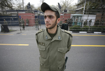 Policeman stands guard in front of British embassy during anti-Britain protest gathering in Tehran