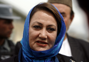 Shahla Ata speaks to media after registration as a candidate for the presidential election at the election commission in Kabul