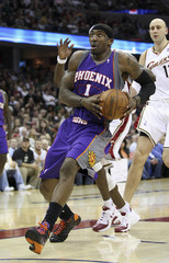 Phoenix Suns' Amare Stoudemire looks to shoot against the Cavaliers in Cleveland