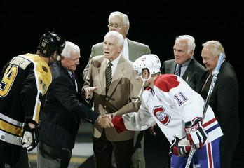 Former Boston Bruins and Montreal Canadiens meet for ceremonial puck drop before NHL season opener in Boston