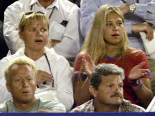 Anna Kournikova (right rear) and her mother (left rear) react to a point [during Mark Philippoussis'..