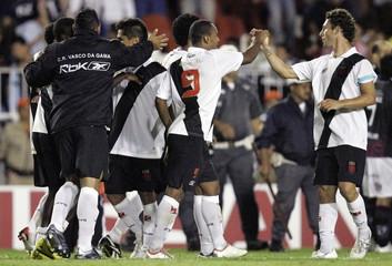 Leandro Amaral of Brazil's Vasco da Gama celebrates with team mates after winning their Copa Sudamericana soccer match against Argentina's Lanus in Rio de Janeiro