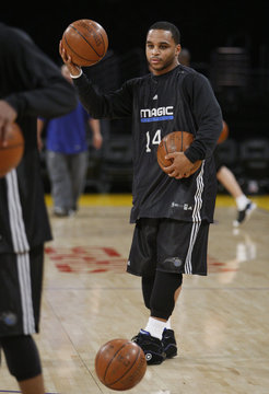 Orlando Magic guard Jameer Nelson gathers some balls on court during practice for the NBA Finals basketball series in Los Angeles