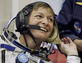 US astronaut Peggy Whitson smiles before boarding the space ship at the Baikonur cosmodrome in Kazakhstan