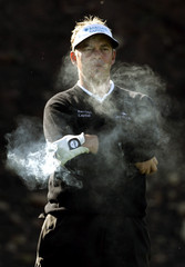 Darren Clarke surrounded by smoke during first round of Accenture world match play golf in Carlsbad.