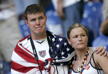 U.S. fans react to their team's loss to the Czech Republic after their Group E World Cup 2006 soccer match in Gelsenkirchen