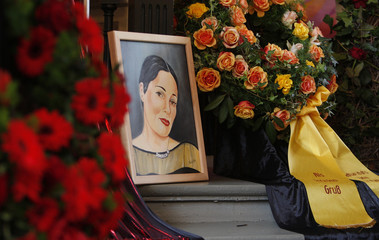 Flowers and wreaths are placed around painting during a funeral service for former prostitute Domenica Niehoff at Reeperbahn in Hamburg
