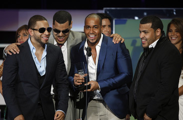 Dominican band El Grupo Aventura receive their award for best tropical album at the 2009 Billboard Latin Music Awards in Miami