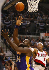 LOS ANGELES LAKERS O'NEAL IS FOULED BY TRAIL BLAZER WELLS.